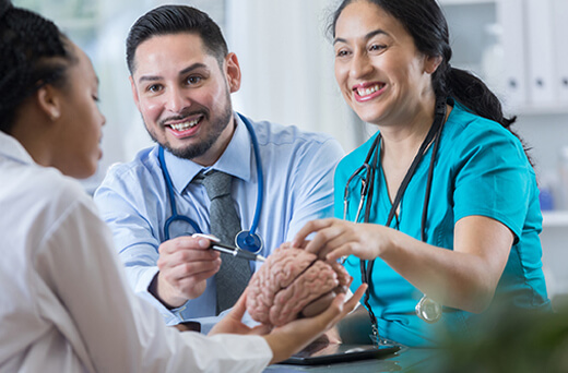 Neurology provider helping patients